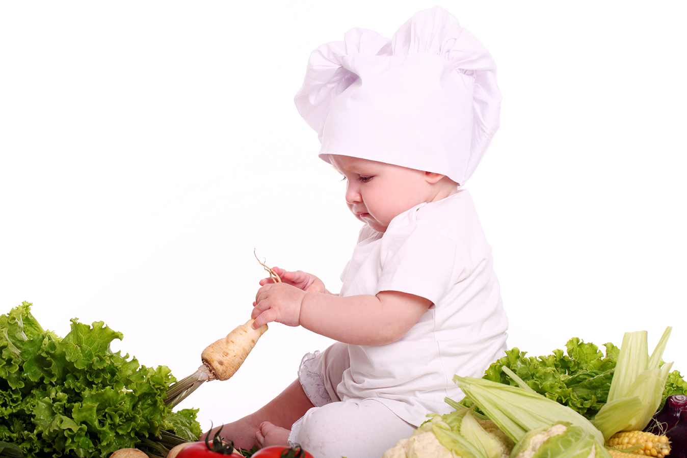 Cute baby chef with different vegetables